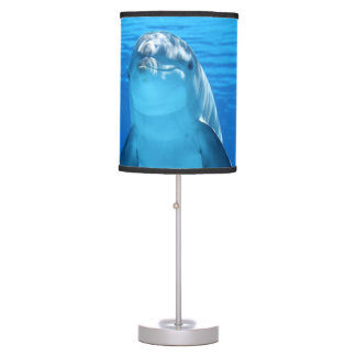 Bottlenose Dolphin looks at the camera under water Table Lamp