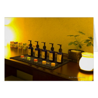 Bottles of aromatherapy oil in the beauty salon, card