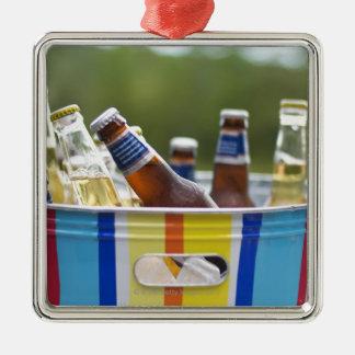 Bottles of beer in ice bucket metal ornament