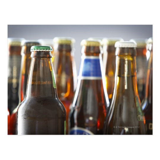 Bottles of various bottled beer in studio postcard