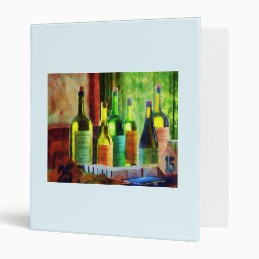 Bottles of Wine Near Window Binder