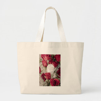 bouquet of red roses with one white rose in center large tote bag