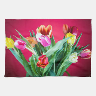 Bouquet of tulips on red towels