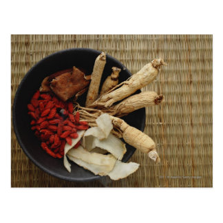 Bowl filled with Chinese medicinal herbs Postcard