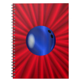 Bowling Ball Over Red Notebooks