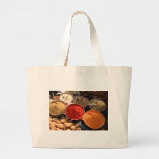 Bowls of cooking spices in Indian market Bag