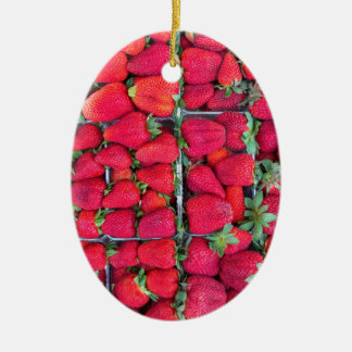 Boxes filled with red strawberries ceramic oval ornament