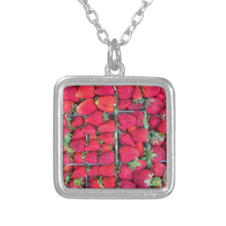 Boxes filled with red strawberries silver plated necklace