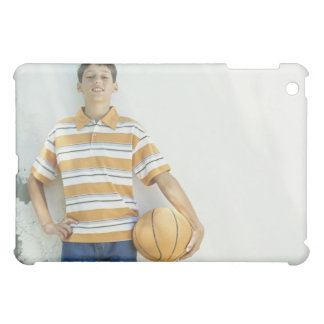 Boy (12-13) standing in front of white cover for the iPad mini