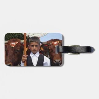Boy and oxen bag tag