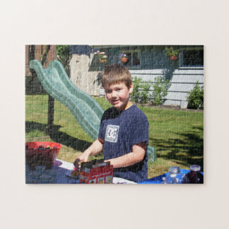 Boy at Snack Table Near Slide Puzzle