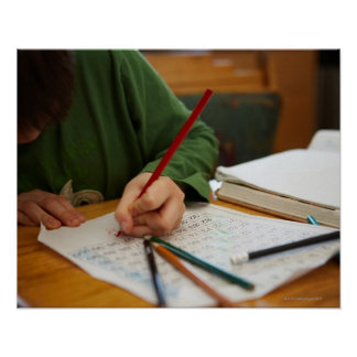 Boy concentrating on math homework poster