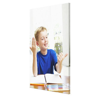 Boy counting on his fingers to complete his stretched canvas print