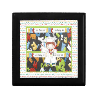 Boy in Cap and Gown with Diploma on ABC Background Gift Box