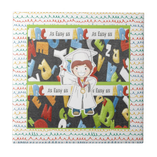 Boy in Cap and Gown with Diploma on ABC Background Tile