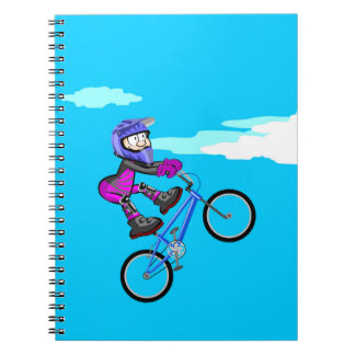 Boy in extremely audacious bicycle BMX Notebooks