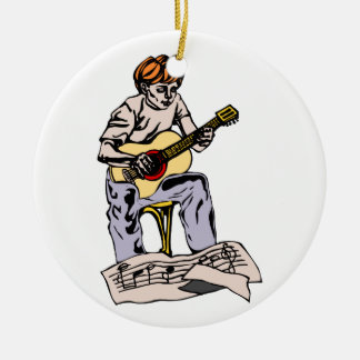 Boy playing acoustic guitar with sheet music ceramic ornament