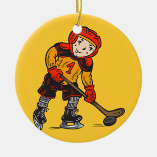 Boy Playing Hockey Round Ceramic Ornament