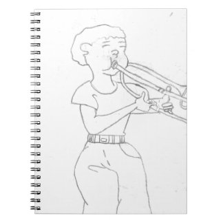 boy playing the trumpet note book