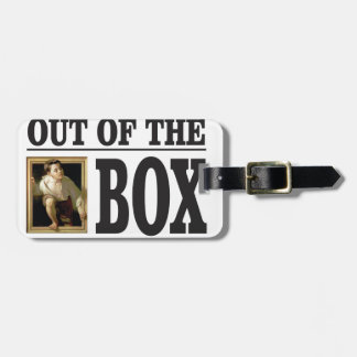 boy pops out of box luggage tag