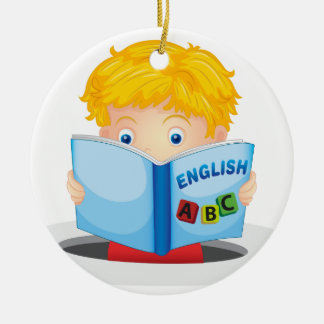 boy reading book ceramic ornament