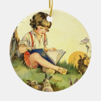 Boy reading under tree with rabbits ceramic ornament