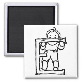 Boy Standing on Letter 'E' - Magnet