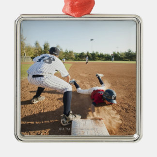 Boys (10-11) playing baseball metal ornament