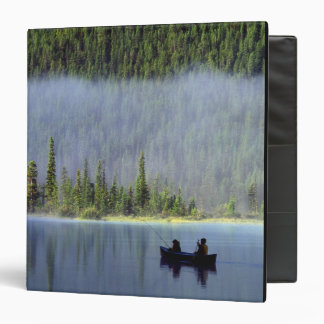 Boys fishing from canoe with mist in binders