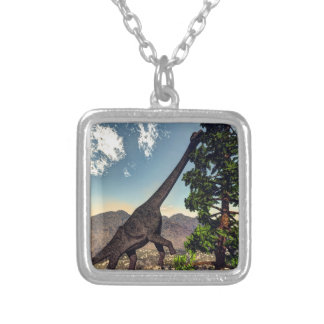 Brachiosaurus dinosaur eating wollomia pine silver plated necklace