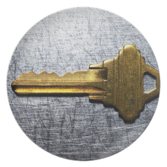 Brass key on stainless steel plate