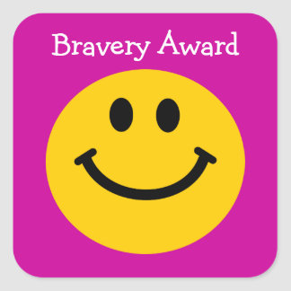 Bravery award yellow smiley face on pink square sticker