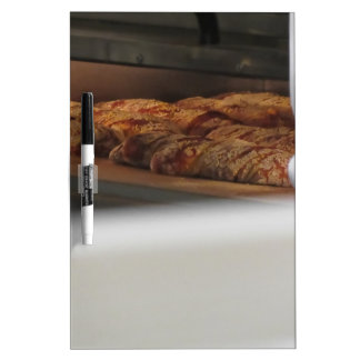 Bread freshly made into the oven dry erase board