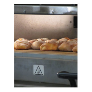 Bread freshly made into the oven postcard
