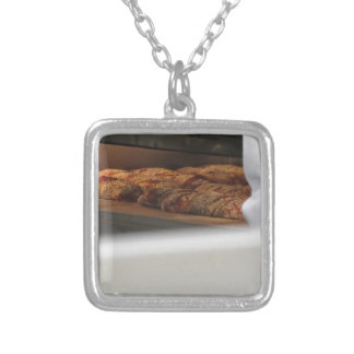 Bread freshly made into the oven silver plated necklace