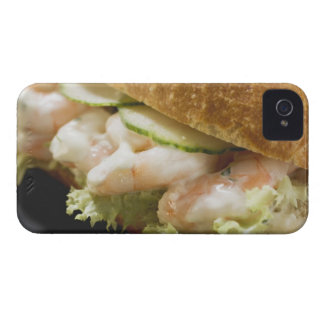 Bread roll filled with shrimps, cucumber and iPhone 4 case