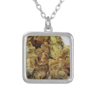 Breaded and fried crunchy vegetables with lemon silver plated necklace
