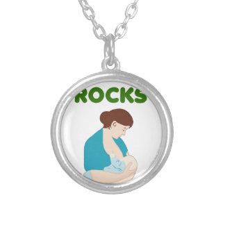 breast feeding mom rocks silver plated necklace