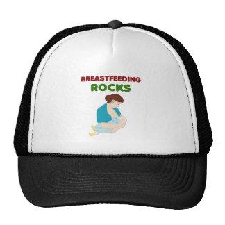 breast feeding mom rocks trucker hat