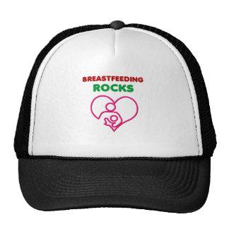 breast feeding rocks, mom with baby trucker hat