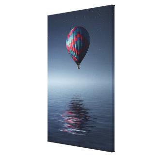 Breathtaking hot-air-balloon over water canvas print