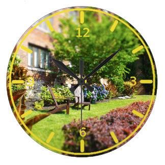Brick Home, Adirondack Wooden Chairs, Shrubs Plaza Large Clock