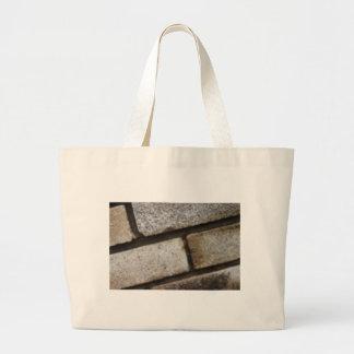 Brick lay background large tote bag