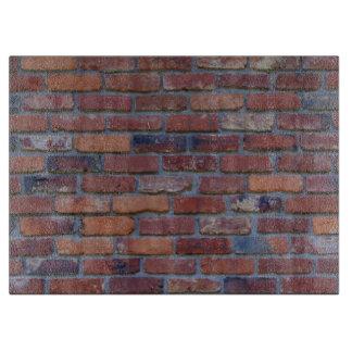 Brick wall - red mixed bricks and mortar boards