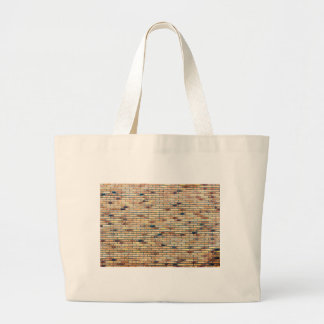 Brick wall with several colors large tote bag