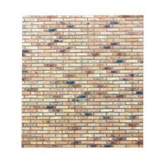 Brick wall with several colors notepads