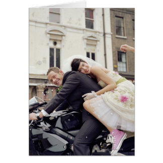 Bride and groom on motorbike, smiling, portrait card