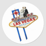 Bride & Groom sitting  on Las Vegas Sign Sticker