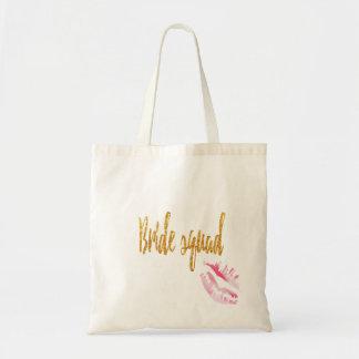 bride-squad-pink-kiss. tote bag