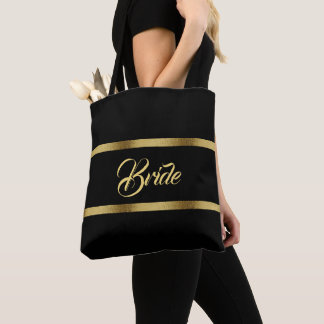 Bride with faux gold ribbons on a black backdrop tote bag